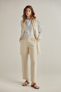 Set of multi-pocket waistcoat, high-waist trousers and pleated shirt.
