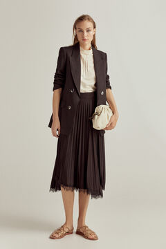 Black suit with pleated details